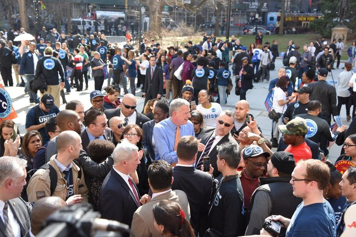 New York City Mayor Bill de Blasio, surrounded by union and AARP supporters, urged City Council to pass zoning laws aime