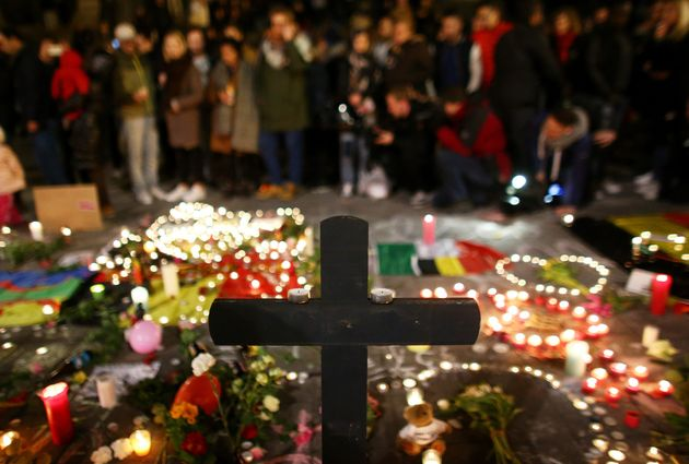 People light candles at the Place de la Bourse following today's attacks on March 22, 2016 in Brussels,