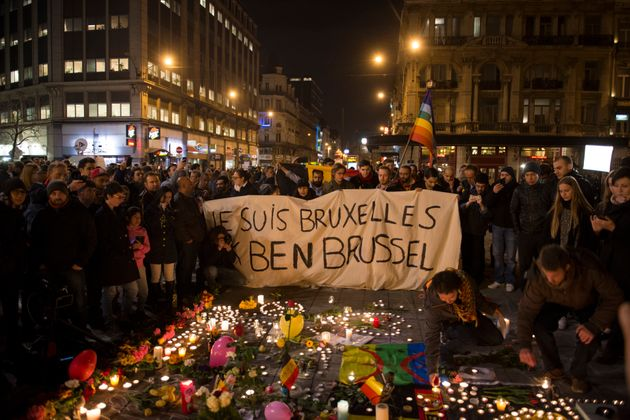 People gather in Brussels' Bourse square on Tuesday