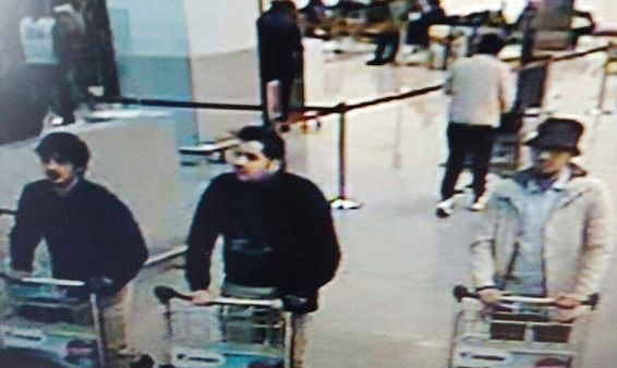 The three men are seen moments before the airport