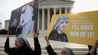 WASHINGTON, DC - MARCH 23:  Nuns supporting Little Sisters of the Poor, attend a rally in front of the US Supreme Court, March 23, 2016 in Washington, DC. Today the high court will hear arguments in Little Sisters v. Burwell, which will examine whether the governments new health care regulation will require the Little Sisters to change their healthcare plan, to other services that violate Catholic teaching.  (Photo by Mark Wilson/Getty Images)