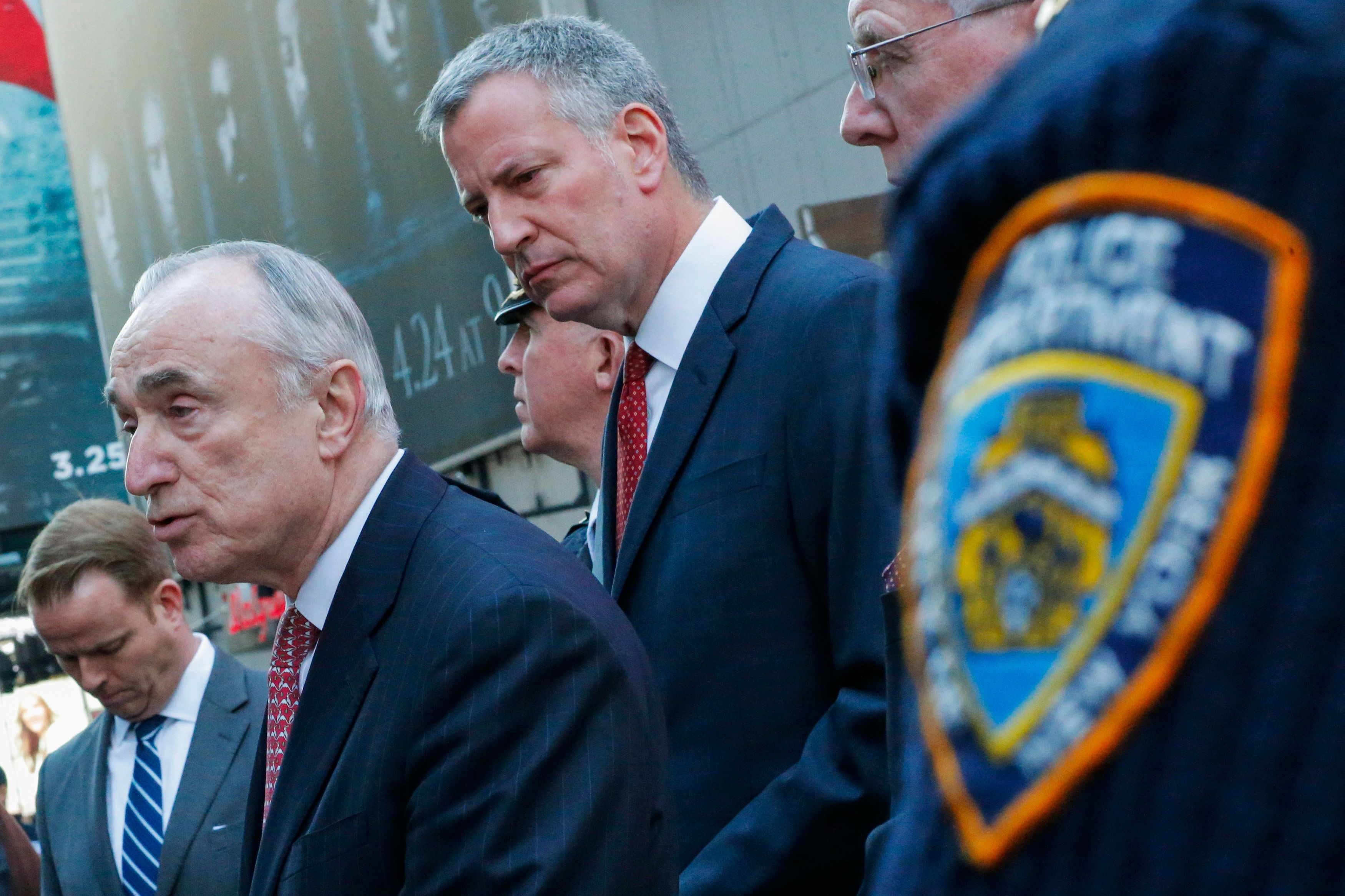 New York Police Commissioner William Bratton (2nd-L) speaks to the media next to New York City Mayor Bill de Blasio (C) in New York, March 22, 2016, following a series of bombings claimed by the Islamic State group in Brussels, Belgium.  Airports across Europe swiftly boosted security, while across the Atlantic, New York and Washington ordered security personnel to key areas. / AFP / EDUARDO MUNOZ        (Photo credit should read EDUARDO MUNOZ/AFP/Getty Images)