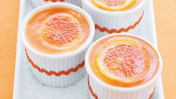 These individual ramekins filled with creamy cheesecake, an orange slice and blood-orange gelatin make for a stunning present