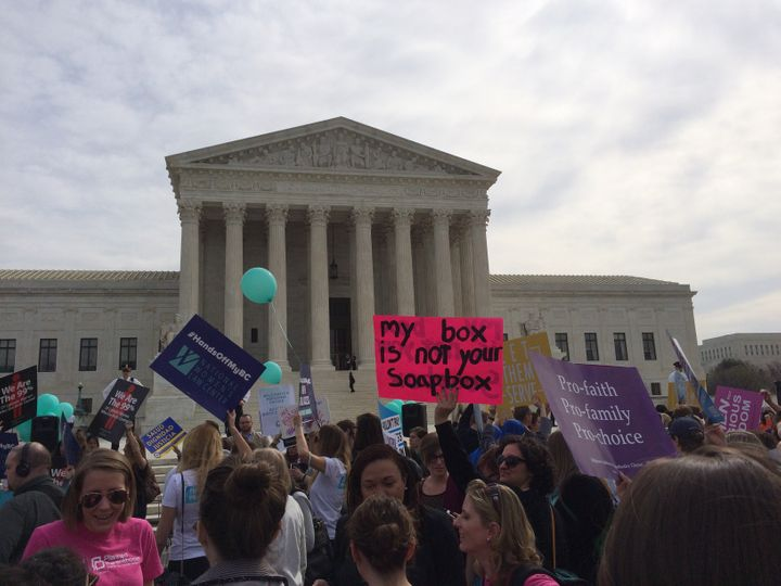 Protesters gather outside the Supreme Court Wednesday, March 23, 2016.