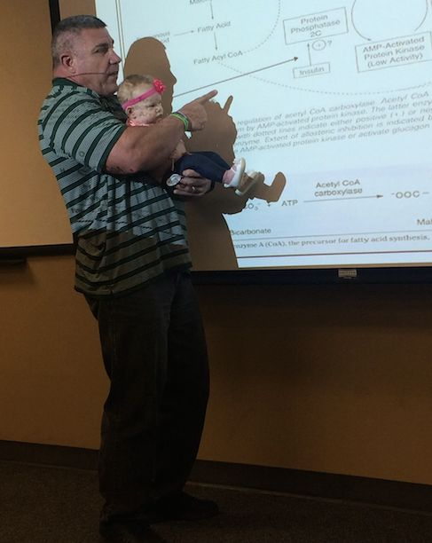 Prof. Darryn Willoughby holding baby Millie.