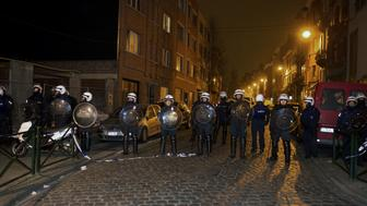 Policemen stand guard the street at Rue de la Carpe in Molenbeek-Saint-Jean in Brussels, on March 19, 2016. Belgian police arrested five people in counter-terror raids in Brussels on March 18, including Paris attacks suspect Salah Abdeslam and the family who sheltered him, prosecutors said. Special federal police forces arrested Abdeslam in Rue des Quatre-Vents, who has been on the run since the deadly November 13 attacks, wounding him lightly in the leg during an afternoon raid in the capital's gritty immigrant neighbourhood of Molenbeek. / AFP / Belga / Nicolas Maeterlinck / Belgium OUT        (Photo credit should read NICOLAS MAETERLINCK/AFP/Getty Images)