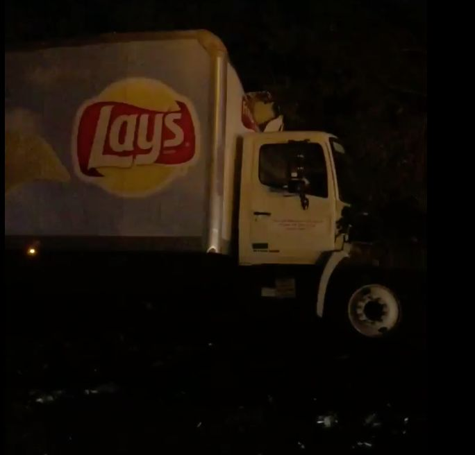 A collision between a potato chips truck and a beer truck left beer and chips covering a Florida highway Wedne