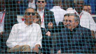 HAVANA, CUBA - MARCH 22:  U.S. President Barack Obama (L) and Cuban President Raul Castro talk before the start of an exhibition game between the Cuban national team and the Major League Baseball team Tampa Bay Devil Rays at the Estado Latinoamericano March 22, 2016 in Havana, Cuba. This is the first time a sittng president has visited Cuba in 88 years.  (Photo by Chip Somodevilla/Getty Images)
