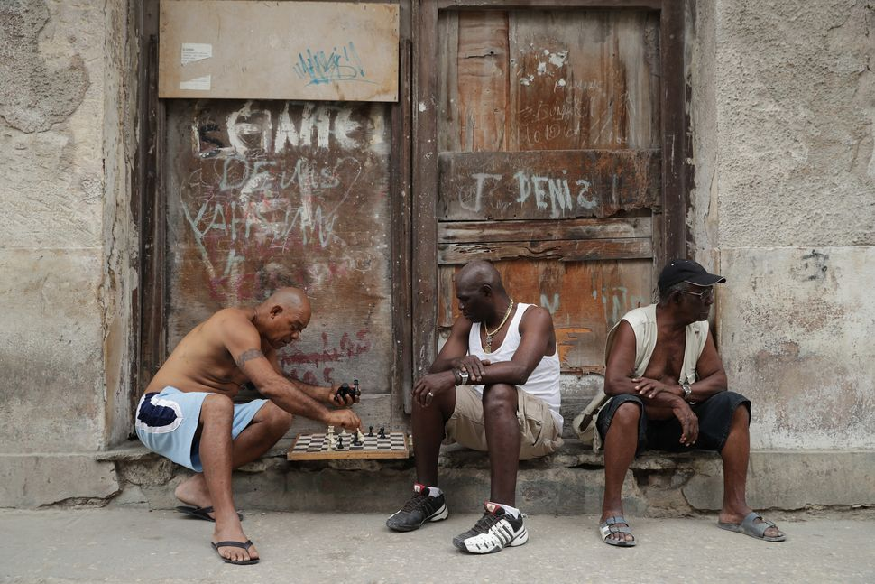 Men play chess in a boarded-up doorway in Old Havana on March 20.
