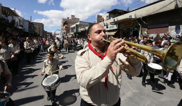 Syrian Christian Roman Catholic scouts parade after a mass marking Palm Sunday in the capital Damascus, on March 20.