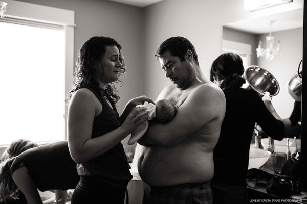 """""""An amazing doula lovingly looks at this sweet girl for the first time in her daddy's arms and so many emotions are running t"""