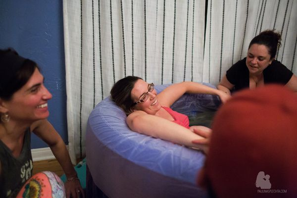 """""""Laboring mother surrounded by her doulas: electrifying joy."""""""