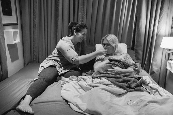"""""""This photograph shows the doula continuing support after baby is born. Postpartum support from doulas is very common, and mo"""