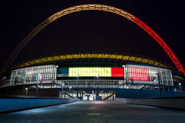 The arches of Wembley Stadium are illuminated with the colours of the flag of Belgium on March 23, 2016...