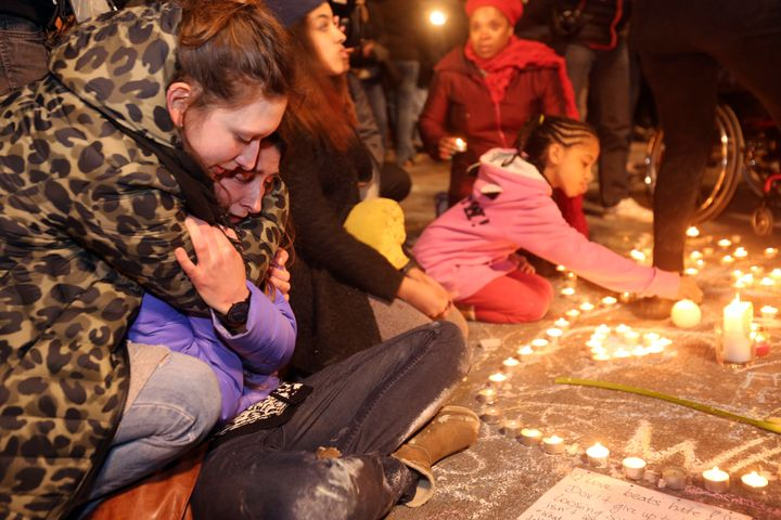 Two young girls cry as people gather to leave tributes at the Place de la Bourse in Brussels, Belgium, following Tuesday's&nb
