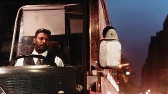 Lorry driver in cab, night