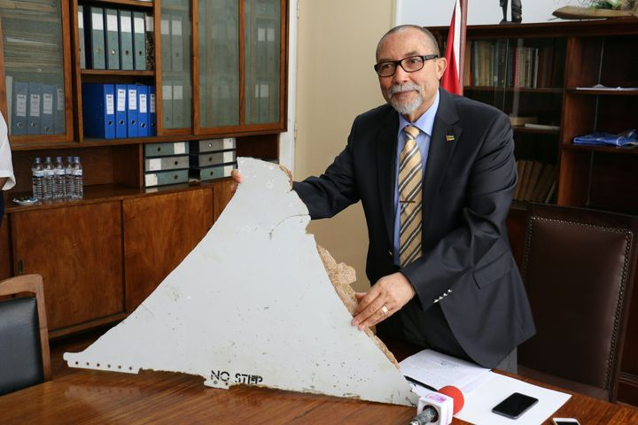 Joao de Abreu, president of Mozambique's Civil Aviation Institute, holds a piece of suspected aircraft wreckage found off the