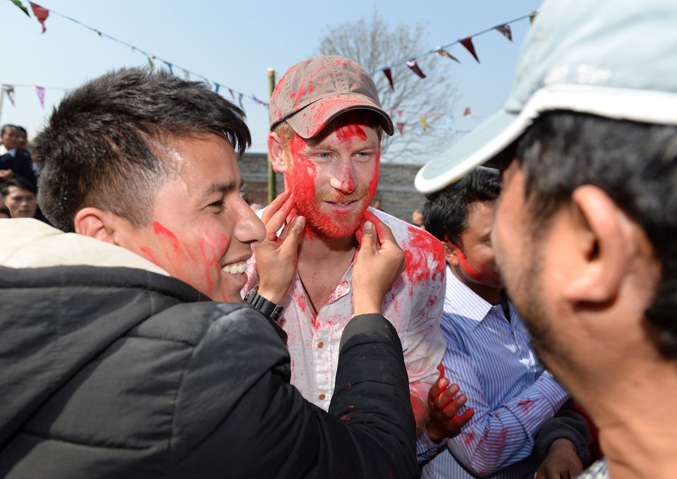 Prince Harry takes part in a holi celebration at Gauda Secondary School on day four of his visit to
