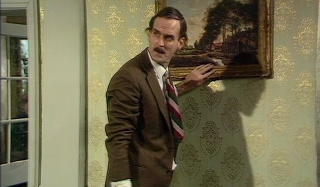 John Cleese as Basil
