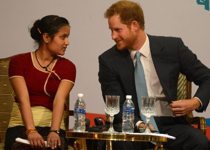 Britain's Prince Harry (R) speaks with a guest during the start of the Nepal Girls Summit 2016 in Kathmandu on March 23, 2016