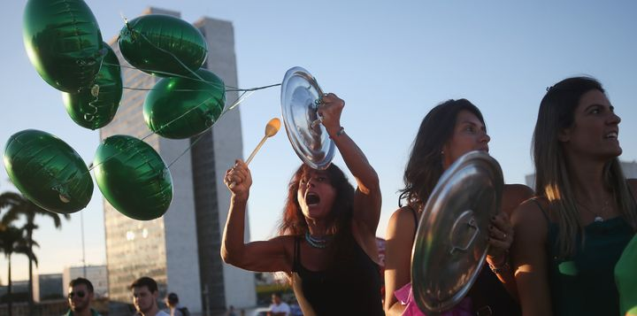 Brazilian anti-government protestors chant outside the National Congress on March 21, 2016 in Brasilia.
