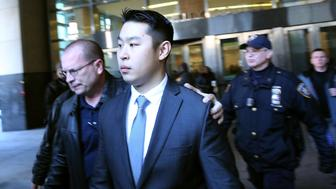 NEW YORK, NY - FEBRUARY 11:  New York City police officer Peter Liang is escorted out of court after he was charged with manslaughter, official misconduct and other offenses on February 11, 2015 in the Brooklyn borough of New York City. Liang pleaded not guilty Wednesday in the November 20 death of 28-year-old Akai Gurley. Liang claims he fired his gun accidentally in a stairwell in the Pink Houses, a public housing complex in East New York. Liang was released without bail. The Brooklyn courtroom was packed with officers and protesters.  (Photo by Spencer Platt/Getty Images)