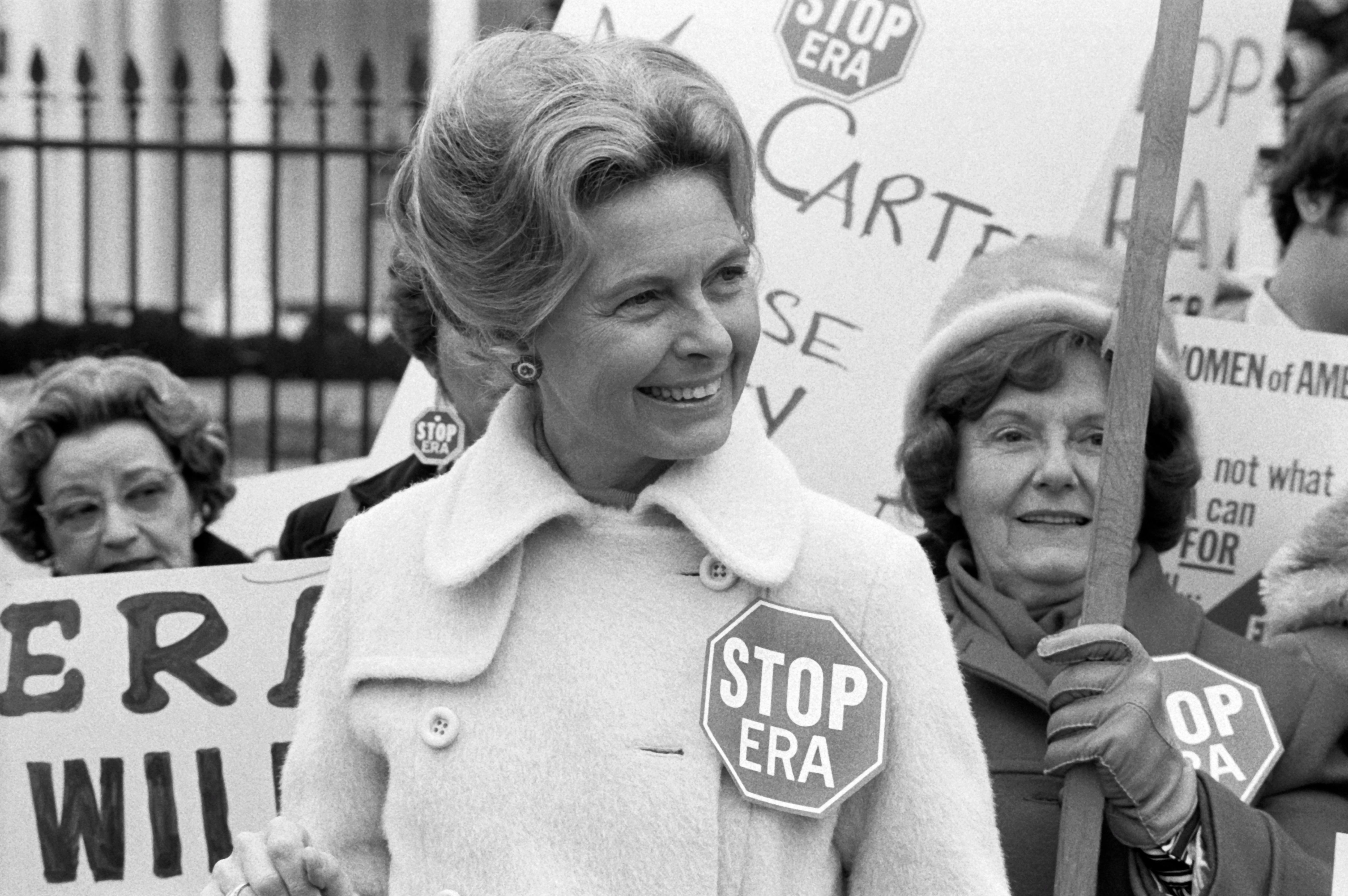 Activist Phyllis Schafly wearing a 'Stop ERA' badge during a demonstration with other women against the Equal Rights Amendment in front of the White House, Washington DC, February 4, 1977. (Photo by Warren Leffler/lcok/Underwood Archives/Getty Images)
