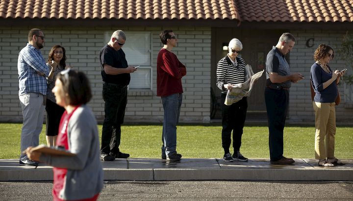 People wait to vote in the U.S. presidential primary election outside a polling site in Arizona on March 22, 2016.