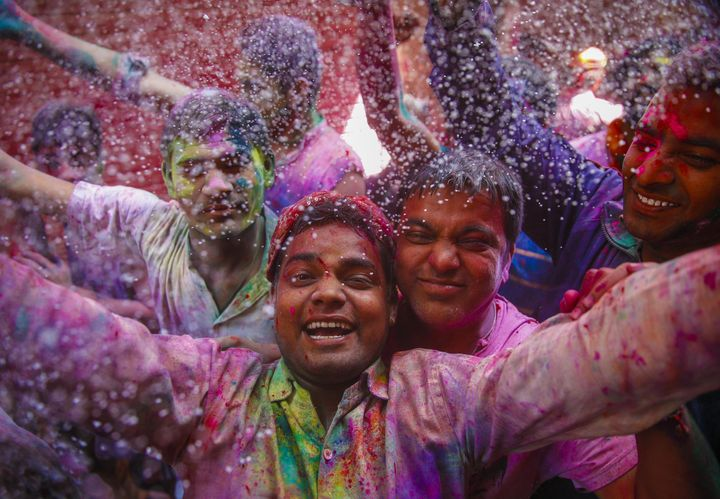 Indians take part in the Holi celebrations in Vrindivan, India on March 24, 2016.