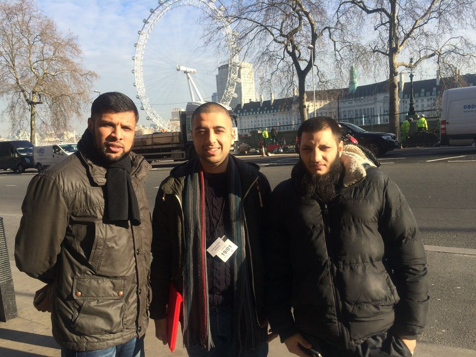 Amad (middle) with two friends after meeting the Justice Select Committee at the House of Commons for...