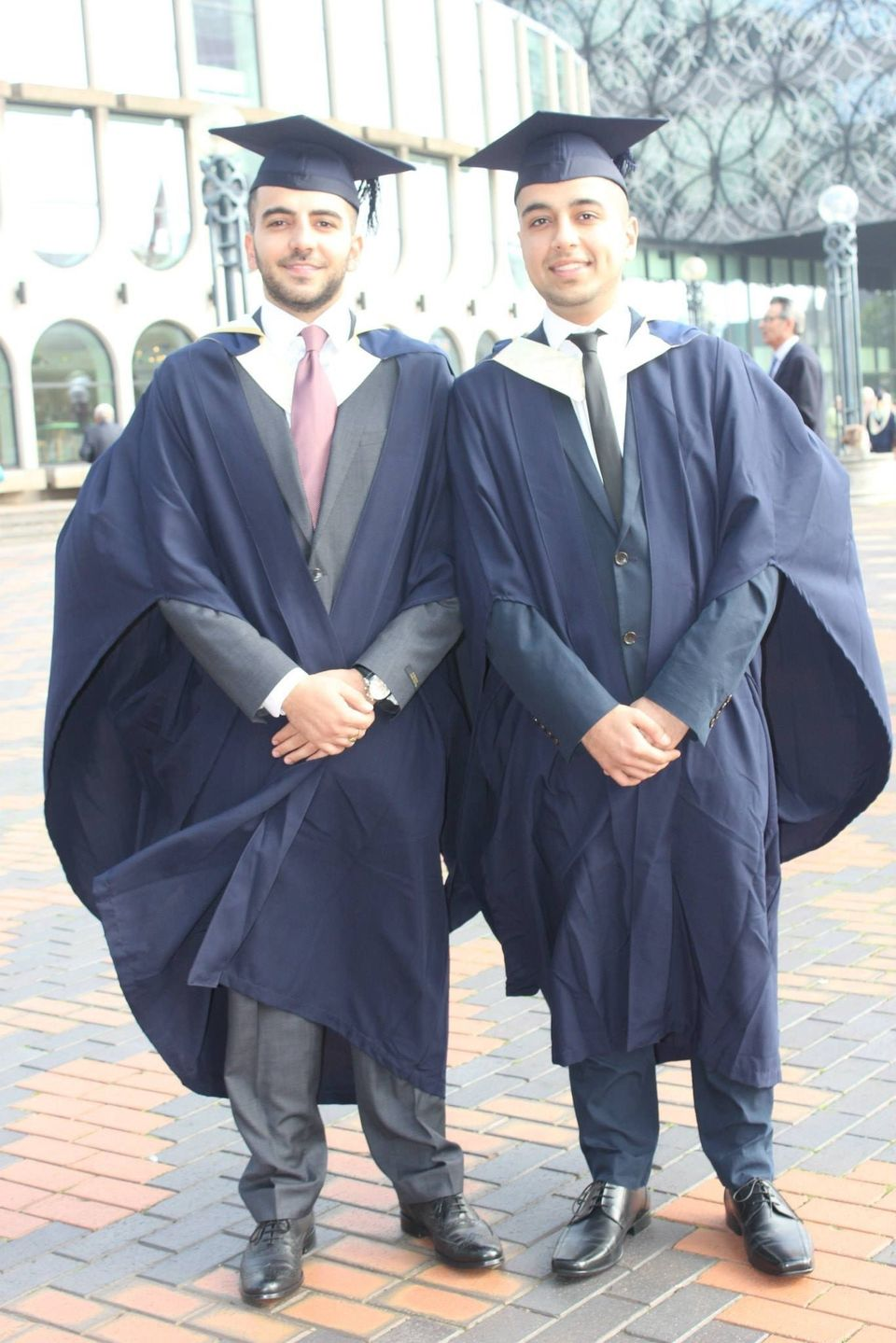 Amad (right) has graduated from a degree in criminology at Birmingham University since