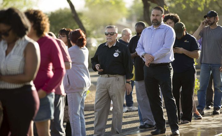 People wait to vote in the U.S. presidential primary election outside a polling site in Glendale, Arizona, March 22, 2016.