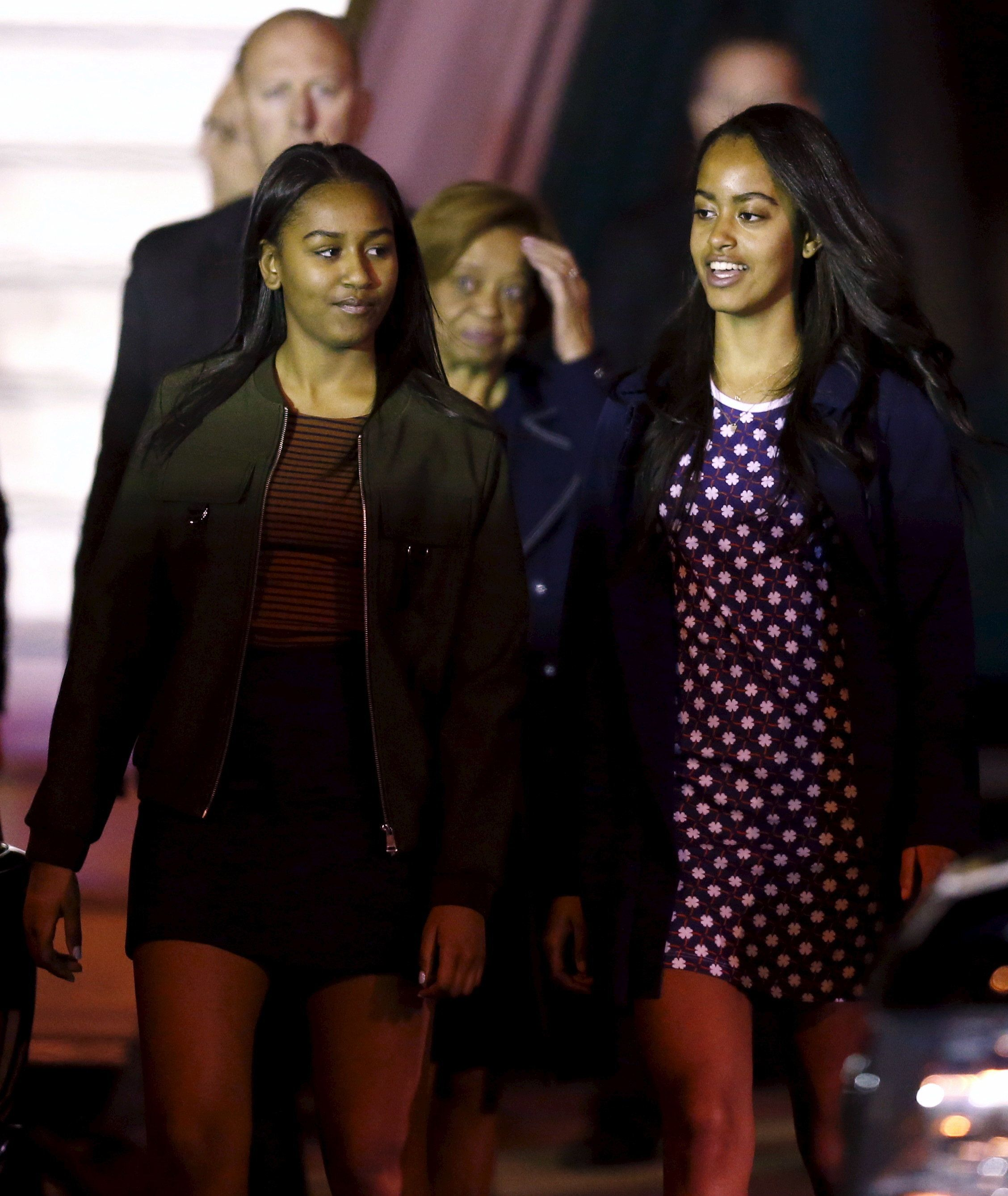 Daughters of U.S. President Barack Obama Sasha (L) and Malia along with Obama's mother-in-law Marian Robinson (C, back) arrive at Buenos Aires' international airport, early March 23, 2016.  REUTERS/Marcos Brindicci