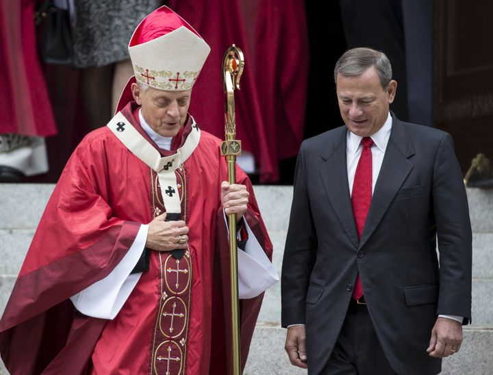Supreme Court Justice John Roberts, right, speaks with Cardinal Donald Wuerl, archbishop of Washington, D.C. on Oct. 4, 2015.