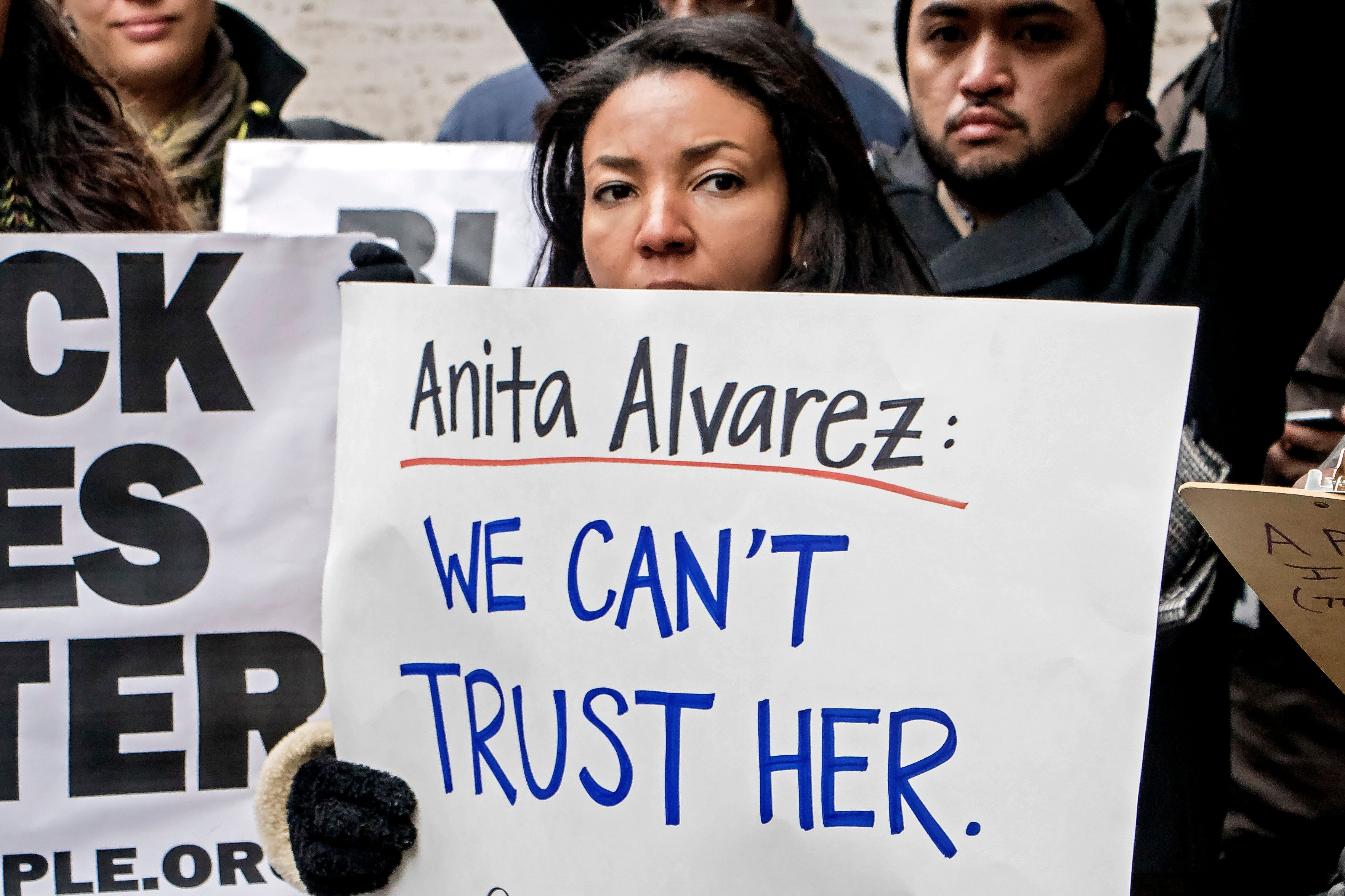 Protesters at a rally in Chicago calling for the removalof Cook County State's Attorney Anita Alvarez.