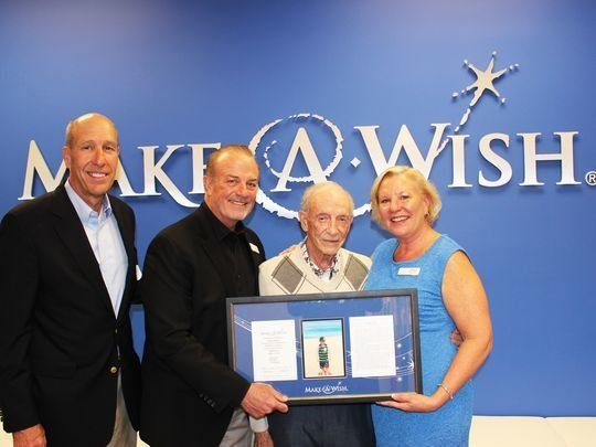 Hartley Gaylord, center, recently accepted a plaque recognizing his late wife Sandy's generous donation.