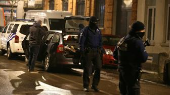 Police officers take part in an operation in Schaerbeek - Schaarbeek, Brussels, late on March 24, 2016.  Six people were arrested on March 24, 2016 in a series of police operations in the Belgian capital, the federal prosecutor's office said, two days after jihadist attacks in Brussels left 31 dead. Raids have also taken place in the Brussels district of Schaerbeek where the three airport attackers left from on March 22 morning carrying three explosive-packed suitcases. There have been no arrests in the neighbourhood. / AFP / Belga / NICOLAS MAETERLINCK / Belgium OUT        (Photo credit should read NICOLAS MAETERLINCK/AFP/Getty Images)