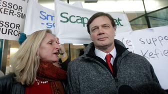 (FILES) This file photo taken on January 28, 2010 shows British doctor Andrew Wakefield (R) and his wife Carmel arriving at the General Medical Council (GMC) in central London. A 1998 study that unleashed a major health scare by linking childhood autism to a triple vaccine was 'an elaborate fraud,' the British Medical Journal (BMJ) charged on January 6, 2011. The study pointed the finger at lead author Andrew Wakefield, then a consultant in experimental gastro-enterology at London's Royal Free Hospital.    AFP PHOTO / FILES / SHAUN CURRY (Photo credit should read SHAUN CURRY/AFP/Getty Images)