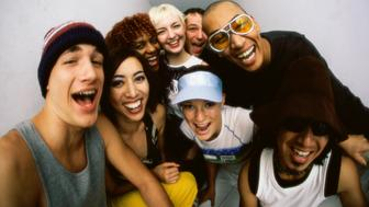 Close-up of a group of young people smiling