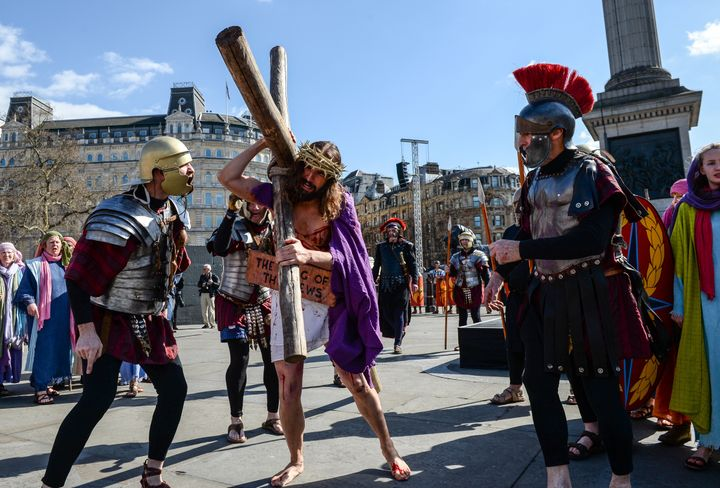 Actor James Burke-Dunsmore carries the crucifix whilst playing Jesus during The Wintershall's 'The Passion of Jesus' in front