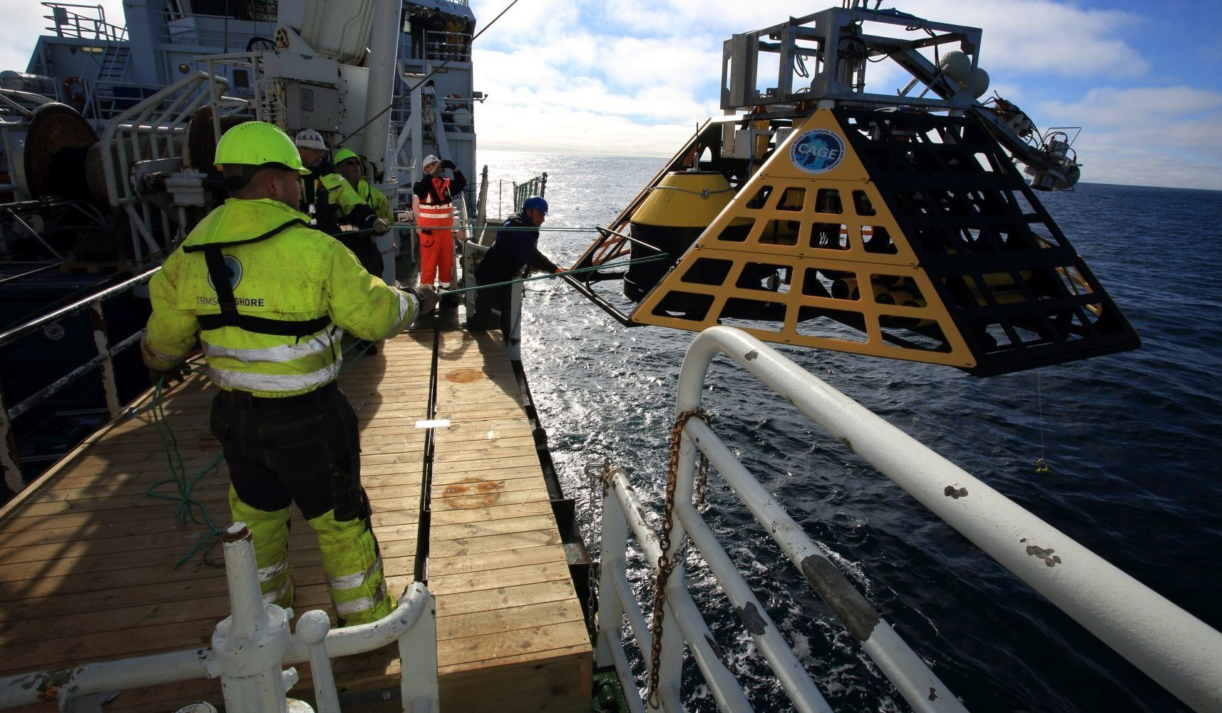 Marine biologist Peter Linke, GEOMAR engineers and deckhands guide a specially-designed lander (commissioned by Norway's Cent