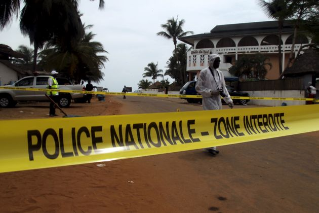 Ivorian police prepare to inspect the area of the hotel Etoile du Sud following an attack by gunmen at...