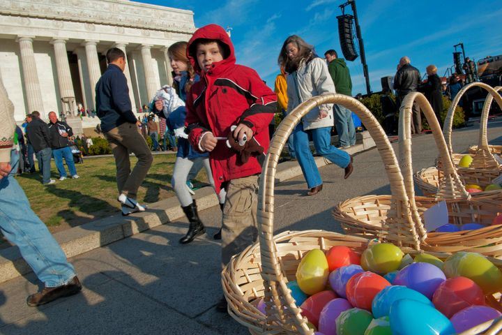 Baskets of candy filled colored plastic eggs entice passers by after the annual sunrise Easter service on the steps of the Li