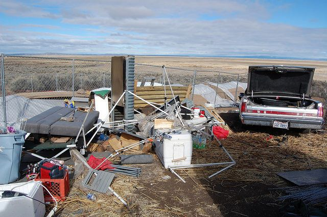 Trash, broken camping equipment and a neglected car litter the area around the Malheur National Wildlife Refuge.