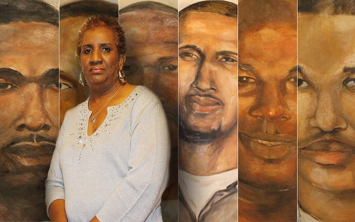 "Sheila Phipps stands next to a portrait she painted of her son, McKinley ""Mac"" Phipps Jr., and other men incarcerated in Loui"