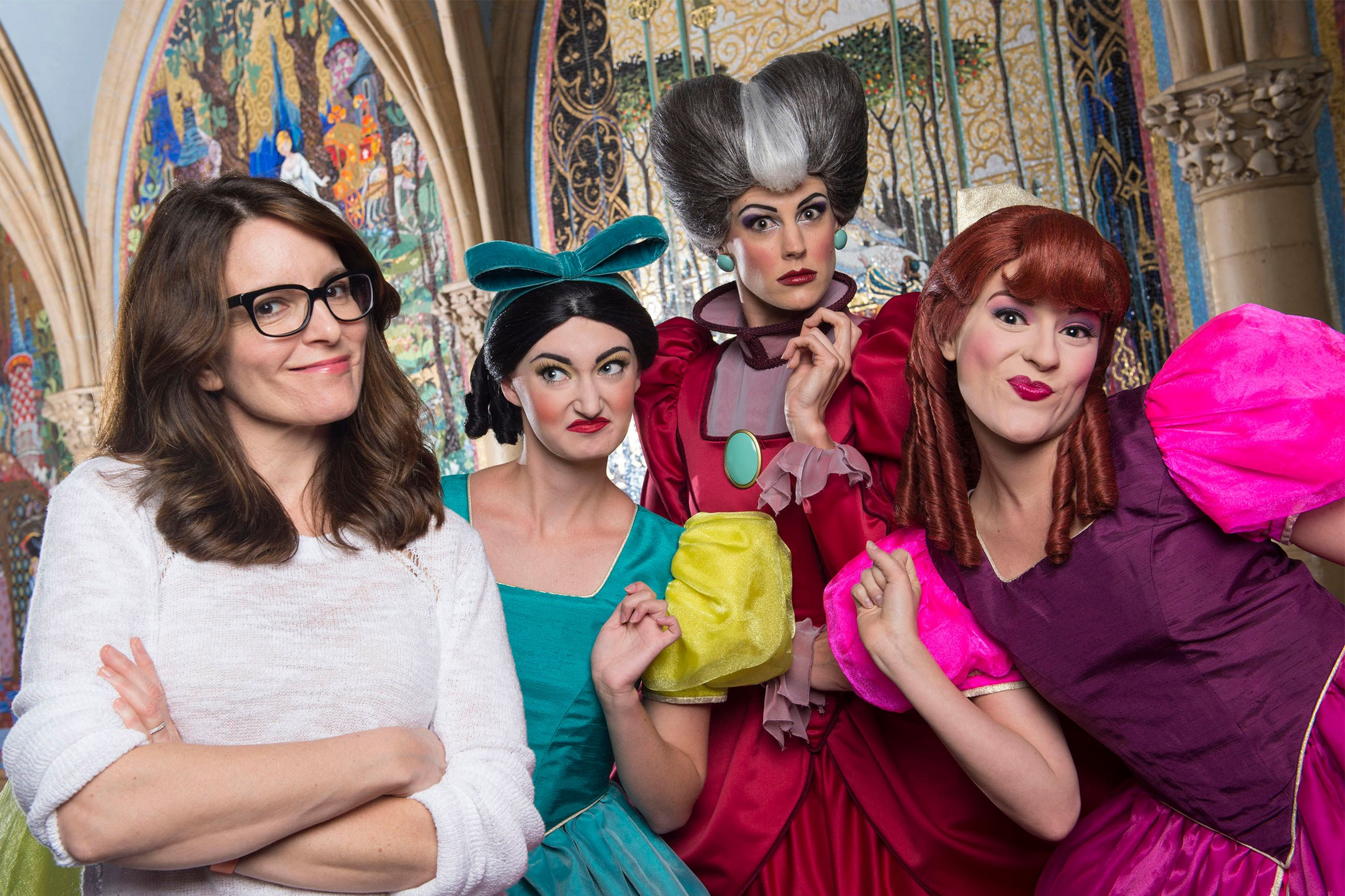 """(March 25, 2016): Emmy, Golden Globe, SAG and People's Choice award-winner Tina Fey poses with Disney's original mean girls, Cinderella's wicked stepmother and stepsisters, March 25, 2016 at Magic Kingdom Park in Lake Buena Vista, Fla. Fey vacationed at Walt Disney World while on break from working on the musical adaptation of the 2004 hit film, """"Mean Girls."""" (David Roark, photographer)"""
