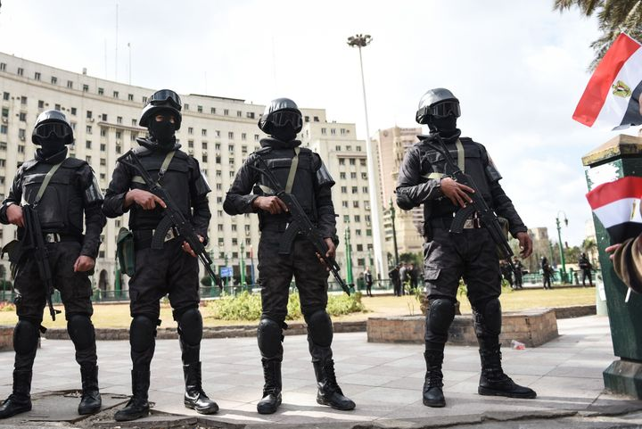 Members of the Egyptian police special forces stand guard on Cairo's landmark Tahrir Square on Jan. 25, the fifth annive