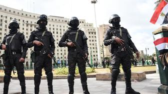 Members of the Egyptian police special forces stand guard on Cairo's landmark Tahrir Square on January 25, 2016, as the country marks the fifth anniversary of the 2011 uprising. Egyptians marked the fifth anniversary of the uprising that toppled Hosni Mubarak amid tight security and a warning from the new regime that demonstrations will not be tolerated. / AFP / MOHAMED EL-SHAHED        (Photo credit should read MOHAMED EL-SHAHED/AFP/Getty Images)