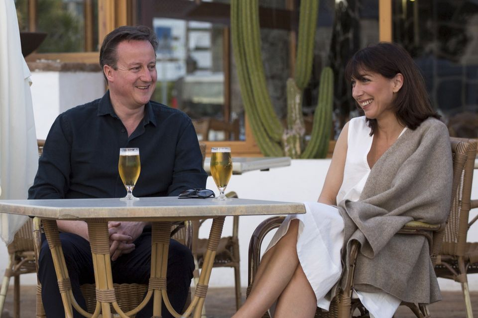 David Cameron and his wife Samantha pose for a photograph during their holiday in Playa Blanca, Lanzarote...