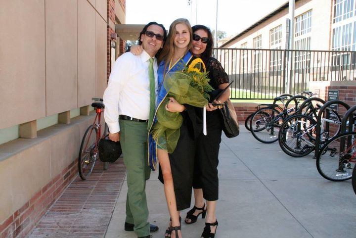 Nile Cappello and her parents at her college graduation.